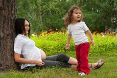 Pregnant woman with baby girl Stock Image