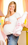 Pregnant woman in baby room Royalty Free Stock Images