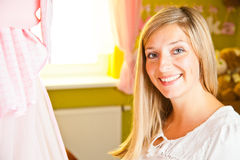 Pregnant woman in baby room Royalty Free Stock Photography