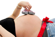 Pregnant woman with baby shoes Royalty Free Stock Photo