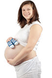 Pregnant woman with baby shoes Royalty Free Stock Photos