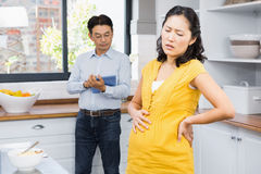 Pregnant woman with back ache Stock Image