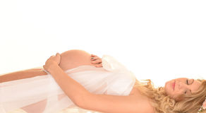 Pregnant woman on back Stock Images