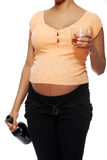 Pregnant woman in a bad habit. stock photography