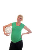 Pregnant Woman and ball. Pregnant Woman holding football ball Royalty Free Stock Image