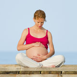 Pregnant woman on beach Stock Photo