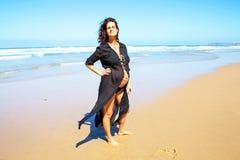 Pregnant woman on the beach at the atlantic ocean Royalty Free Stock Photos