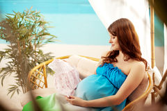 Pregnant woman on the beach in bungalow Stock Photography