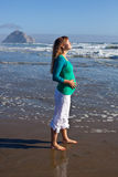 Pregnant woman on beach Stock Photography