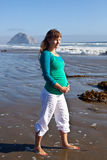 Pregnant woman on beach Royalty Free Stock Images