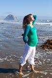 Pregnant woman on beach Stock Photos