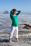 Pregnant woman on beach Stock Image