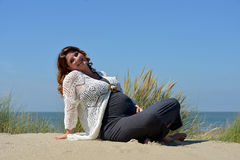 Pregnant woman on the beach Royalty Free Stock Images