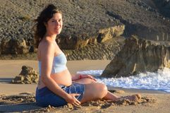 Pregnant woman at the beach Stock Images