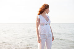 Pregnant woman in beach with white light in Mediterranean Royalty Free Stock Images
