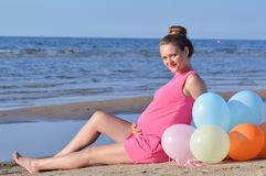 Pregnant woman on the beach Stock Photography
