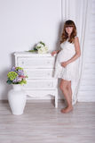 Pregnant woman in beautiful interior Stock Image