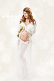 Pregnant woman. Beautiful pregnancy: long curly hair and chiffon Royalty Free Stock Photo