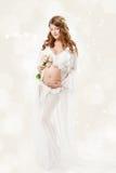 Pregnant woman. Beautiful pregnancy: long curly hair and chiffon Royalty Free Stock Photo