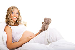 Pregnant woman in bed Stock Photos