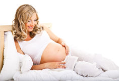 Pregnant woman in bed Stock Image