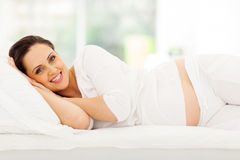 Pregnant woman bed Royalty Free Stock Photo