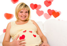Pregnant woman in bed. Royalty Free Stock Images
