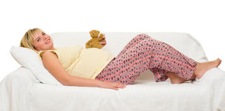 Pregnant woman in bed Royalty Free Stock Images