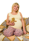 Pregnant woman in bed Stock Photo