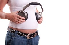 Pregnant woman belly with headset Stock Photos