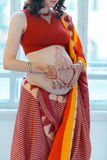 The pregnant woman belly with henna tattoo Stock Image