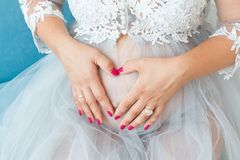Pregnant woman belly, pregnancy heart shape, love sign Stock Photo