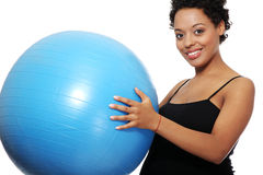 Pregnant woman with big blue gymnastic ball Stock Image