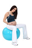 Pregnant woman on birth ball Royalty Free Stock Images
