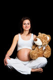 Pregnant woman  on black Stock Photos