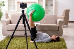 The pregnant woman blogger doing physical exercises royalty free stock images