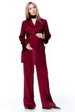 Pregnant woman blond hair wear style fashion red silk suit for m Royalty Free Stock Images