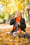 Pregnant woman blow bubbles in autumn park Royalty Free Stock Images