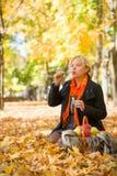 Pregnant woman blow bubbles in autumn park Stock Images