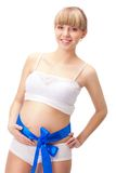 Pregnant woman  with blue bow on belly Royalty Free Stock Image