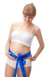 Pregnant woman  with blue bow on belly Royalty Free Stock Photos