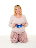 Pregnant woman with blue bow. On white royalty free stock photos