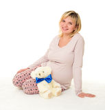 Pregnant woman with blue bow. On white royalty free stock images