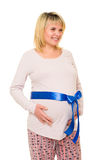 Pregnant woman with blue bow on white Royalty Free Stock Photos