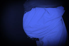 Pregnant woman, blue filter Stock Photos