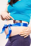 Pregnant woman with blue ribbon showing ultrasound scan of baby, concept of expecting for newborn. Pregnant woman with blue ribbon showing ultrasound scan of royalty free stock photos