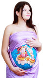 Pregnant woman with body art. I painting on her belly isolated on white background Stock Photography
