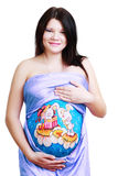 Pregnant woman with body art Stock Images