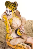 Pregnant woman with body-art as leopard Stock Photo
