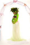 Pregnant woman with body-art with green leaves Royalty Free Stock Photos
